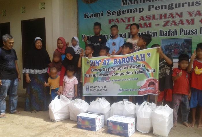 Foto bersama donatur dan kaum dhuafa serta panti asuhan/foto;dunan/progres.id/