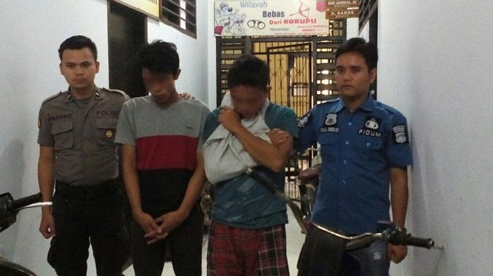 Kedua tersangka yang telah diamankan jajaran Polres Rejang Lebong/foto: Hasan Basri/PROGRES.ID